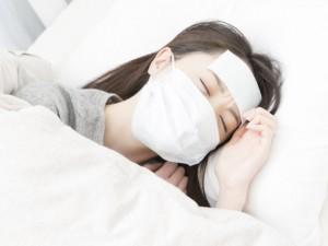 風邪の女性の写真